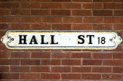 Hall Street British Vintage Street Signs against Red Brick Wall Royalty Free Stock Photography