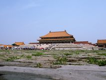 Hall of Supreme Harmony. Of the fobidden city,the palace museum,beijing,china.with a vast plaza in front of it,the crowd,blue sky and green grasses making the Royalty Free Stock Photo