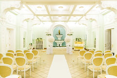Hall for wedding ceremonies. Brihgt fancy hall for wedding ceremonies decorated with flowers Royalty Free Stock Image