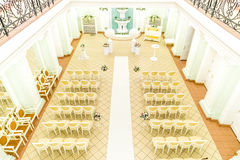 Hall for wedding ceremonies. Brihgt fancy hall for wedding ceremonies decorated with flowers view from above Stock Image
