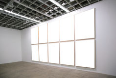 Hall with white frames Royalty Free Stock Images