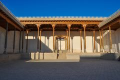 Hall with wooden columns of the ancient citadel in Bukhara `Ark citadel`. royalty free stock photos