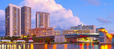 Hallandale Beach Florida. Modern buildings and colorful illuminated bridge at sunset Stock Photos