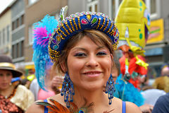 Halle Carnival. HALLE, BELGIUM-MARCH 30, 2014: Member of Bolivian team in national costume participates in defile during yearly Halle Carnival Royalty Free Stock Photo