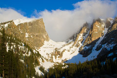 Hallett Peak and Flattop Peak in Rocky Mountain National Park. Clouds swirl over Hallett and Flattop peaks in Rocky Mountain National Park in Estes Park Colorado Royalty Free Stock Photography