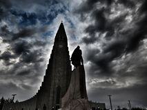 Hallgrímskirkja at Reykjavik. The church Hallgrímskirkja at Reykjavik. With a statue of Leif Eriksson in front. Heavy manipulated Royalty Free Stock Photography