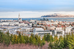 Hallgrimskirkja Cathedral with skyline in Reykjavik Iceland. Beautiful view of  Reykjavik winter in Iceland winter season with snow-capped mountain in the Royalty Free Stock Images