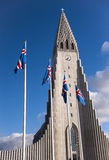 Hallgrimskirkja church and National Icelandic flags during the Independence day in Reykjavik, Iceland Stock Images