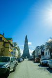 Hallgrimskirkja at the end of the street in Reykjavik. REYKJAVIK, ICELAND - APRIL 9 - 2016: Hallgrimskirkja at the end of the street in Reykjavik royalty free stock photos