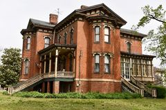 Halliday House. This is a Spring picture of the iconic Halliday House located in Cairo, Illinois in Alexander County. This brick house is an example of royalty free stock image