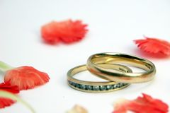 Hallmarked Wedding and Eternity Rings. Gold hallmarked wedding and eternity rings amongst romantic pink petals stock photos