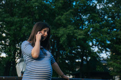 Hallo 2. Future mom having a call Royalty Free Stock Photography
