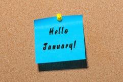 Hallo Januar - Geschäftskonzept mit Text - geschrieben auf den Aufkleber festgesteckt an der Anschlagtafel Stockfotos