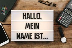 Hallo, mein Name ist..., German text for Hello, My Name is. Hallo, mein Name ist, German text for Hello, My Name is, vintage style light box on office desktop stock images