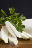 Halloumi cheese. Closeup of halloumi (traditional cypriot cheese) slices Royalty Free Stock Photography