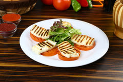 Halloumi cheese. Frying in grill pan stock photography