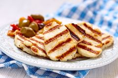 Halloumi cheese. Grilled halloumi cheese with olives and pepers Royalty Free Stock Photo