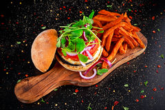 Halloumi cheese, mushroom Burger with sweet potatoes fries. concept of health food.  Stock Image