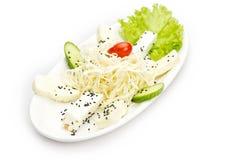 Halloumi cheese plate served with sesame & veggies Stock Photos