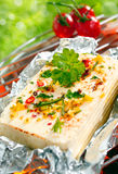 Halloumi cheese grilling in tin foil Royalty Free Stock Images