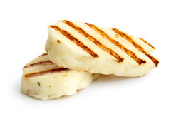 Halloumi cheese. Two grilled slices of halloumi cheese  on white in perspective. With grill marks Royalty Free Stock Images