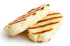 Halloumi cheese. Two grilled slices of halloumi cheese  on white in perspective. With grill marks Stock Photography