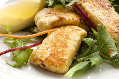 Halloumi Salad. With lemon.  Traditional Greek eating Stock Images
