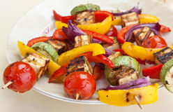 Halloumi and vegetable kebabs. On a plate Royalty Free Stock Image