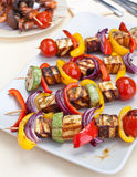 Halloumi and vegetable kebabs on a table Royalty Free Stock Photography