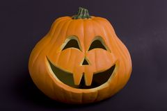 A Hallowe'en Pumpkin. Halloween pumpk infront view on black Royalty Free Stock Image
