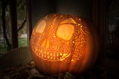 Hallowe`en pumpkin carved in Day of the Dead style stock photos
