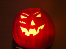 Halloween. Pumpkin head with candle inside Stock Photos