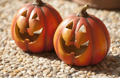 Halloween. Orange ceramic pumpkin with a wicked smile Stock Photography