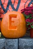 Halloween. A carved pumpkin being used as part of a sign welcoming guests to a fall festival stock photography