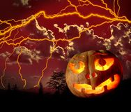 Halloween 4. Halloween pumpkin against red sky with clouds and lightning Royalty Free Stock Image