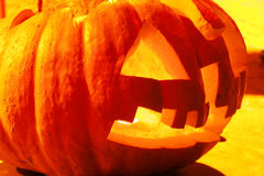 Halloween. A big smiling halloween pumpkin isloated on yellow Royalty Free Stock Photography