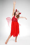 Halloween. Cute little girl in red Halloween costume Stock Photography