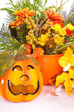 Halloween. Decoration with pumpkin and flowers Stock Image