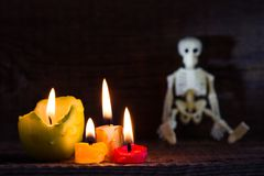 Halloween abstract background with skeleton and candles on cemetery Royalty Free Stock Photos