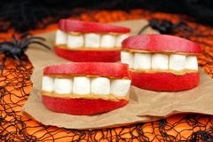 Halloween apple, marshmallow and peanut butter monster teeth Stock Photos