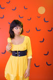Halloween is approaching. Girl in horror. Against the background of bats and the moon Royalty Free Stock Photo