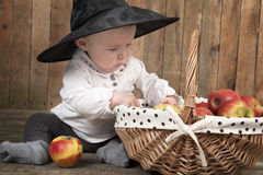 Halloween baby with basket of apples Stock Photography