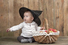 Halloween baby with basket of apples Royalty Free Stock Photos