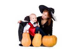 Halloween baby boy with mother witch near pumpking Royalty Free Stock Image