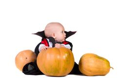Halloween baby boy with pumpking 1 Royalty Free Stock Photo