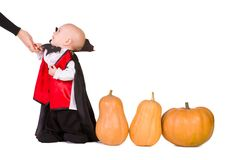 Halloween baby boy with pumpking Royalty Free Stock Image