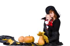 Halloween baby with mother near pumpking Stock Image
