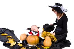 Halloween baby with mother near pumpking Stock Photo