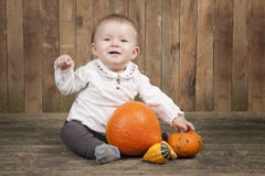 Halloween baby with pumpkins Royalty Free Stock Photos