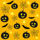 Halloween back 2. Seamless yellow background for Halloween with pumpkins and bats Royalty Free Stock Photography